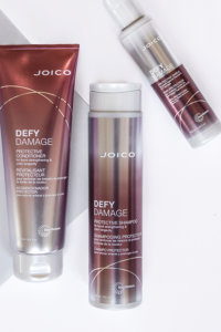 defy damage shampoo conditioner and shield bottles