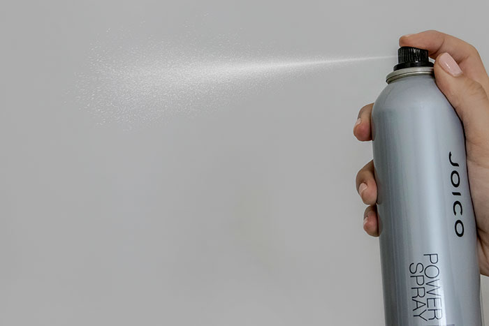 Power Spray spraying from bottle