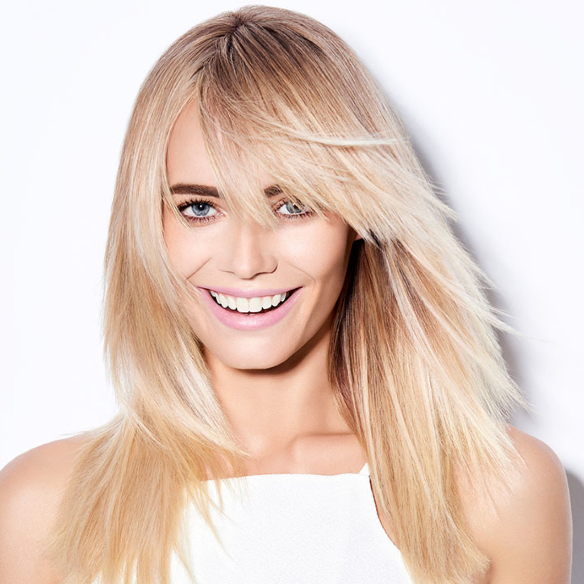 Sunkissed coastal blonde hair color technique model after