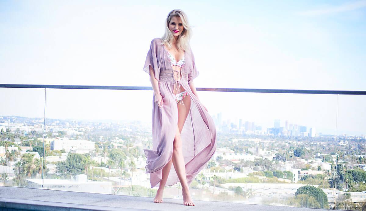 Beautiful Blonde in purple kimono next to pool