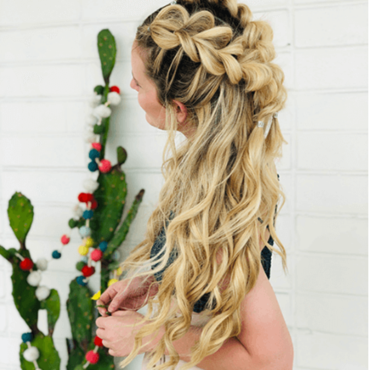 Beautiful thick blonde hair in big braid and loose curls