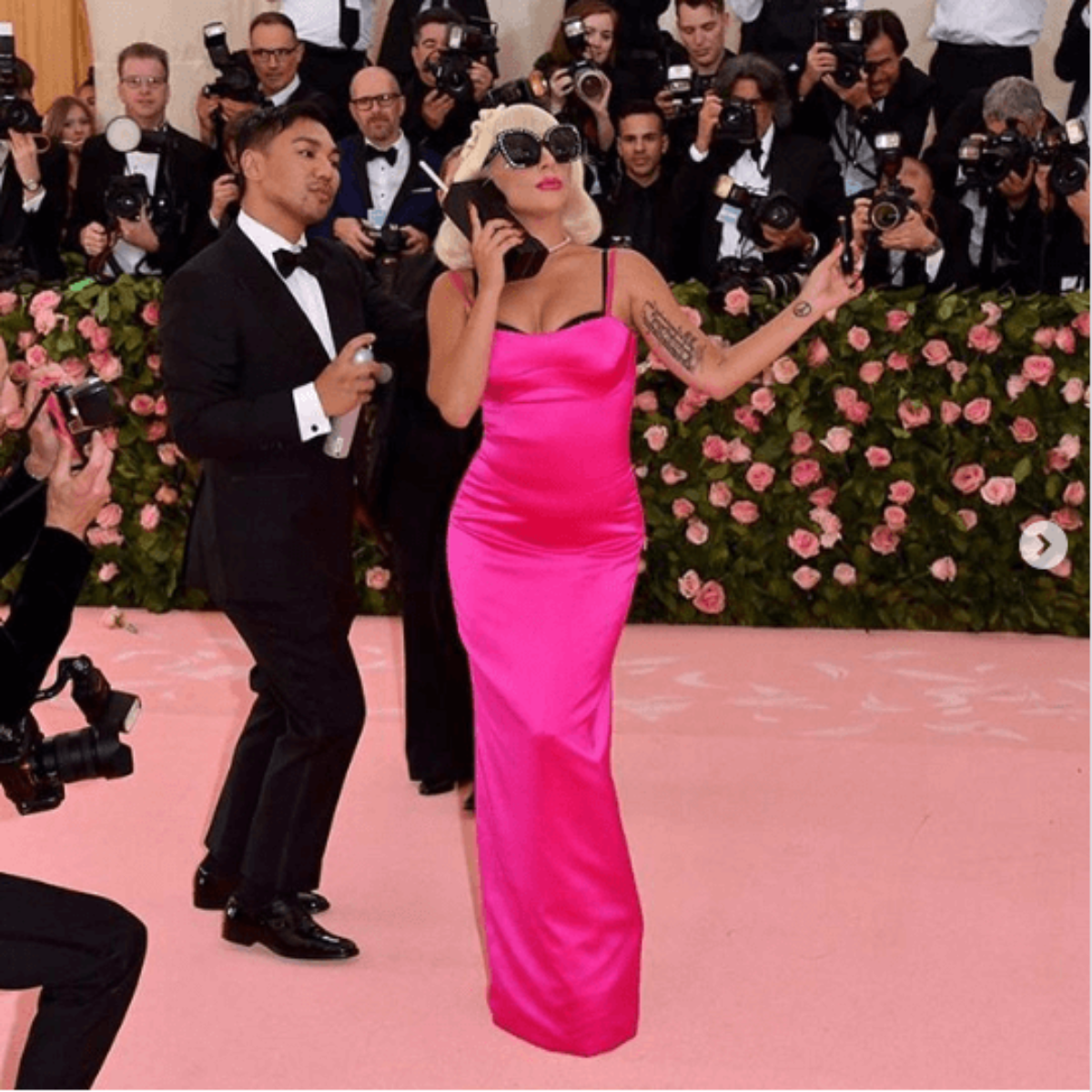 Lady Gaga at Met Gala in hot pink dress and blonde bob