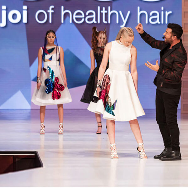 Richard Mannah on stage with hair model