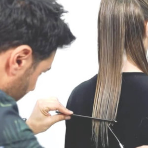 Richard Mannah cutting hair