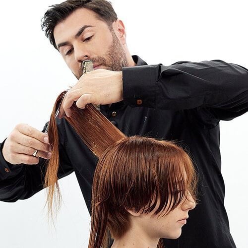Hairstylist Richard Mannah cutting a bob