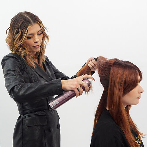 Hairstylist Larisa Love prepping clients hair
