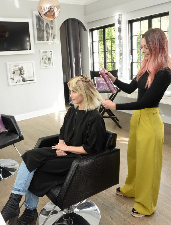 Hairstylist Jill Buck coloring hair