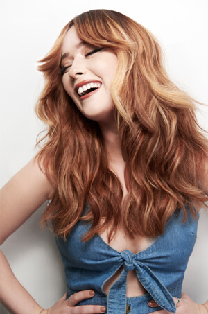 Woman with long red hair smiling