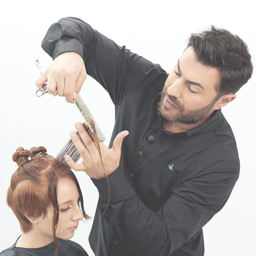 Hairstylist Richard Mannah coloring clients hair