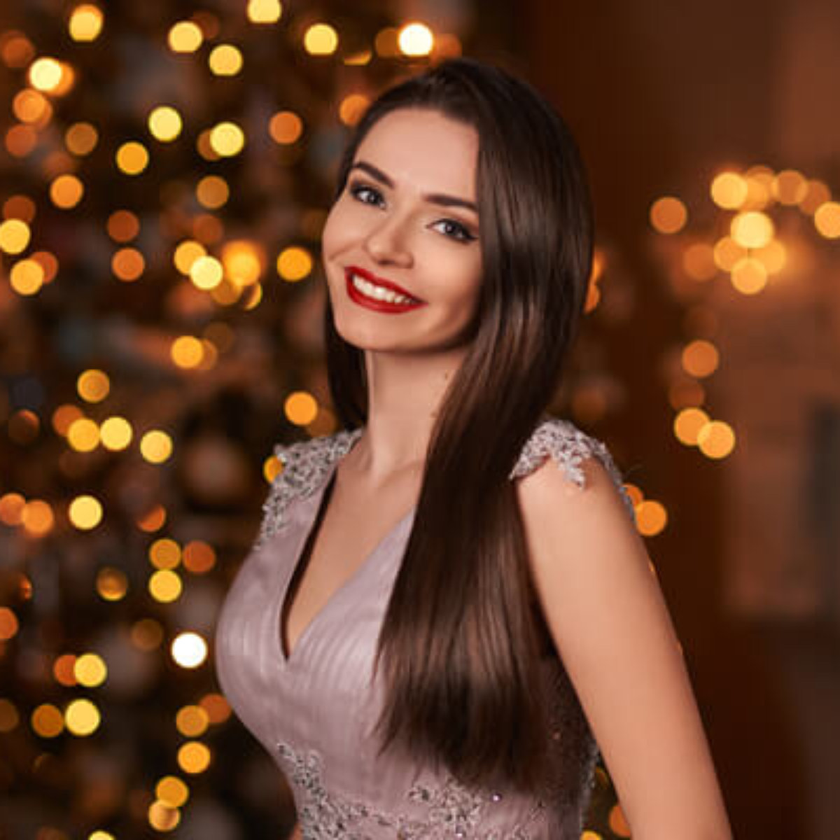 Women smiling by Christmas tree