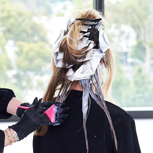 Hair being colored in foils