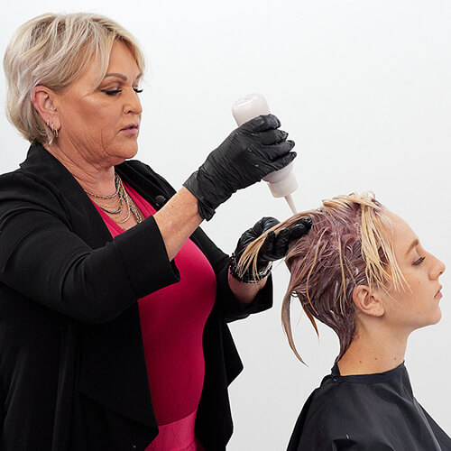 Hairstylist Cherry Pentenbrink coloring clients hair