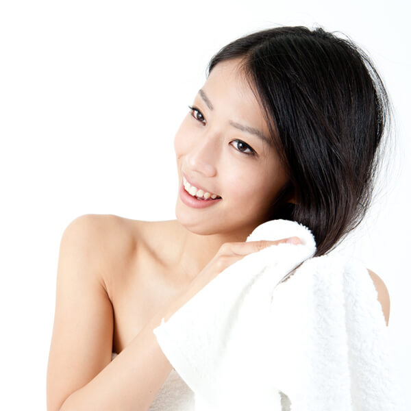 Woman towel drying hair