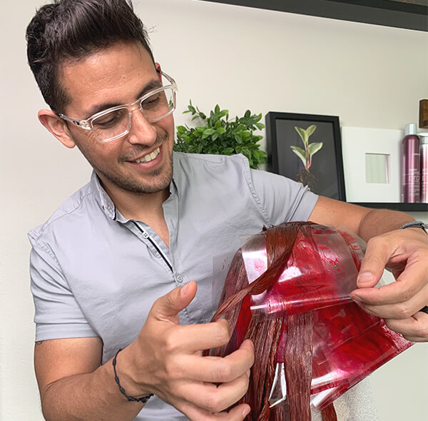 Hairstylist Ricardo Santiago foiling hair