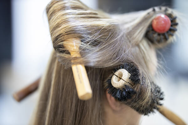 Women with hair brush tangled in hair