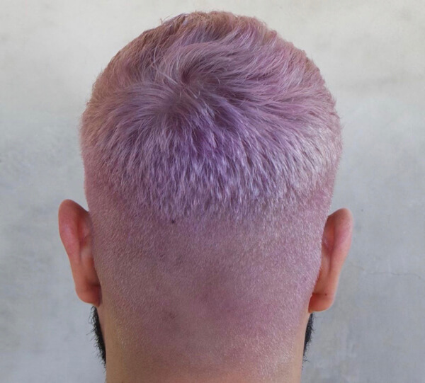 Man with short pink buzzed hair