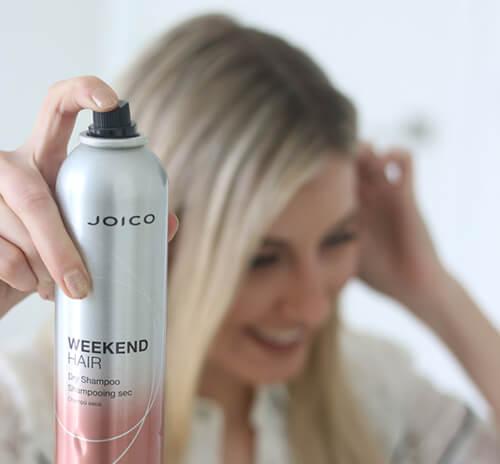 Women holidng bottle of Joico Dry Shampoo